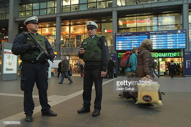German policemen armed with a submachine gun keeps a watchful eye among travelers at Hauptbahnhof main railway station on November 17 2010 in Berlin...