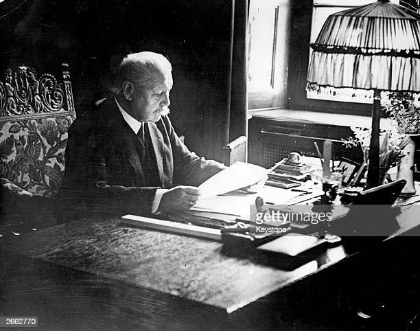 German politician and field marshal Paul von Hindenburg working at his desk in the presidential office in Berlin Original Publication People Disc...