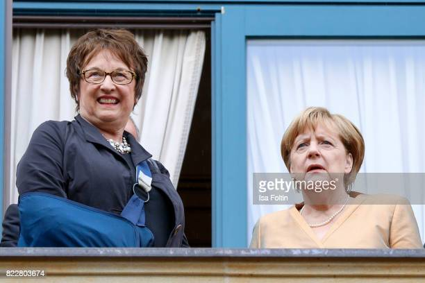German politician Brigitte Zypries and German chancellor Angela Merkel attend the Bayreuth Festival 2017 Opening on July 25 2017 in Bayreuth Germany