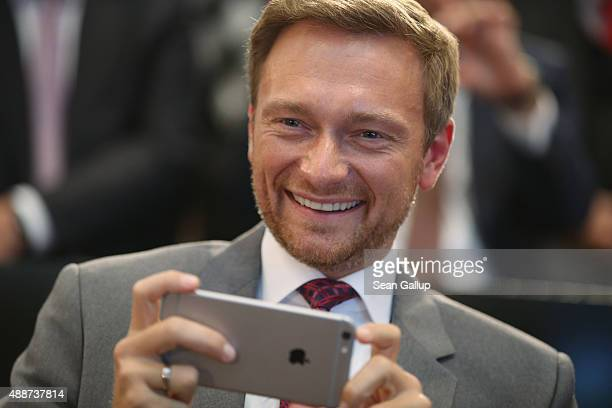 German politician Christian Lindner of the FDP political party smiles with an Apple iPhone as he attends the Walther Rathenau Award ceremony on...