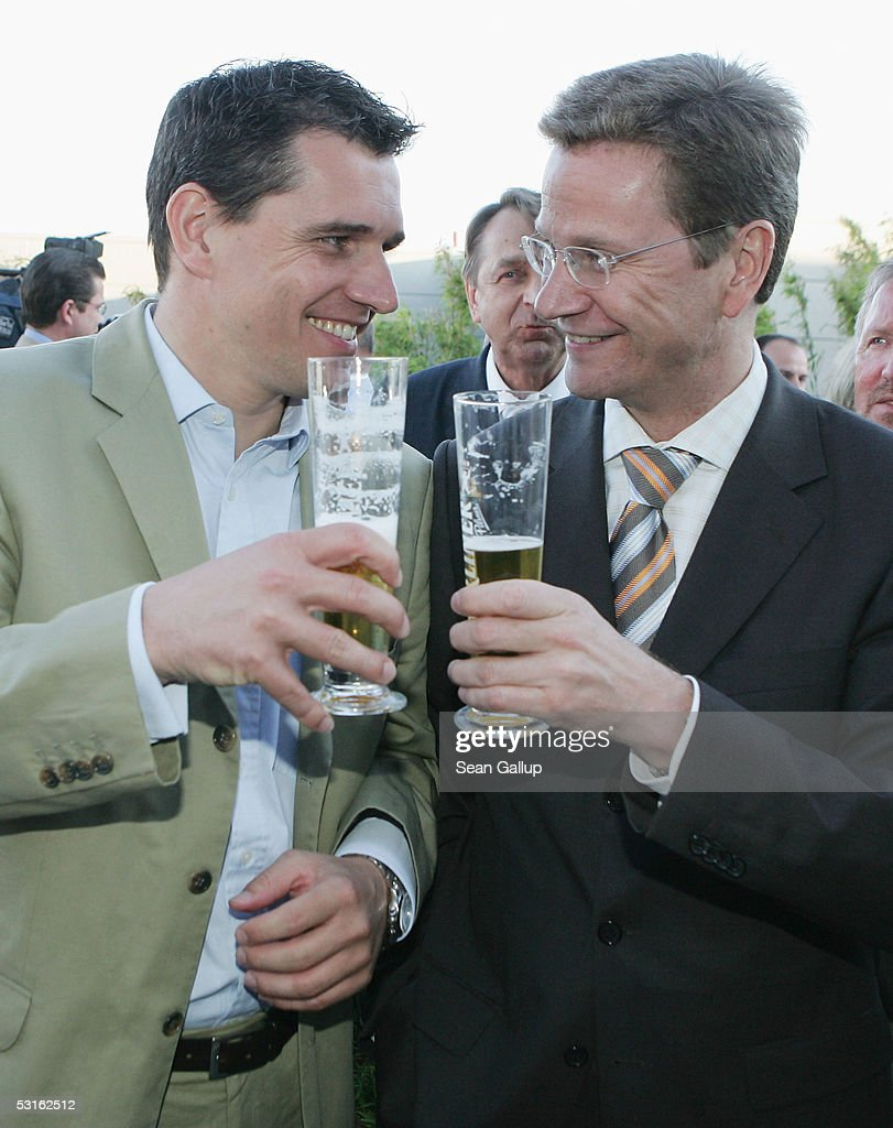 German politician <a gi-track='captionPersonalityLinkClicked' href=/galleries/search?phrase=Guido+Westerwelle&family=editorial&specificpeople=208748 ng-click='$event.stopPropagation()'>Guido Westerwelle</a> (R) and his partner <a gi-track='captionPersonalityLinkClicked' href=/galleries/search?phrase=Michael+Mronz&family=editorial&specificpeople=762924 ng-click='$event.stopPropagation()'>Michael Mronz</a> attend the Bild Summer Party at the Axel Springer publishing house June 28, 2005 in Berlin, Germany.