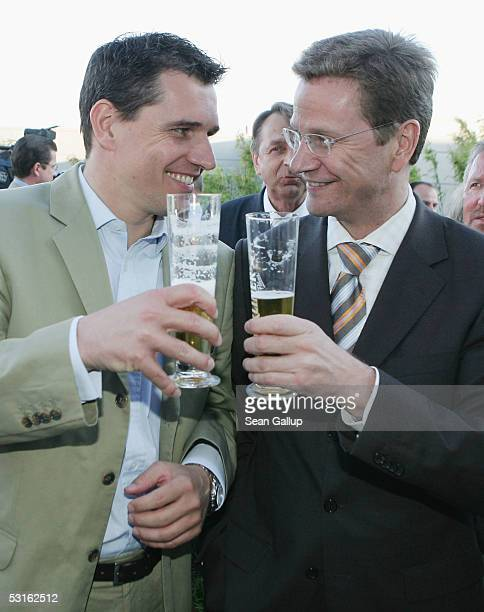 German politician Guido Westerwelle and his partner Michael Mronz attend the Bild Summer Party at the Axel Springer publishing house June 28 2005 in...