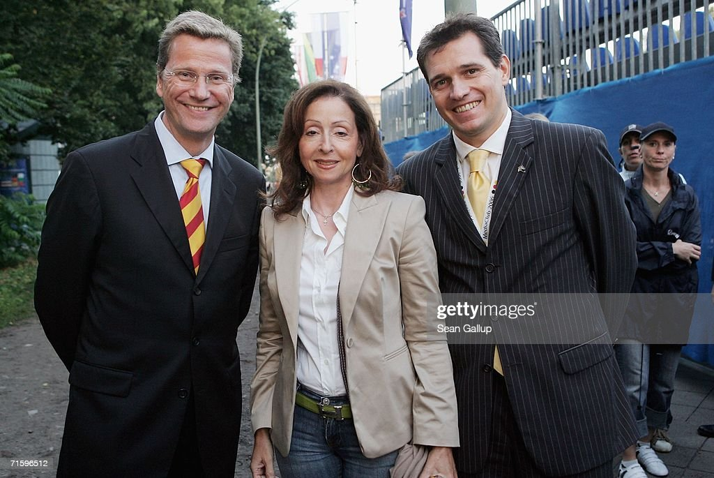 German politician Guido Westerwelle (L), singer Vicky Leandros and Westerwelle's partner Michael Mronz pose for a photograph after attending a promotional event near the Brandenburg Gate for the World Equestrian Games August 6, 2006 in Berlin, Germany. The games will take place in Aachen starting August 20.