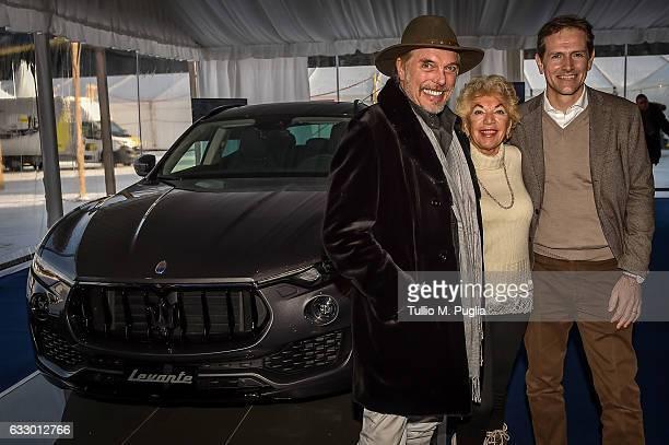 german polo player Ingo Pico Ljuba ManzLurje of Manz Lurie Privacy Hotel Switzerland and his husband Marco Conte pose near a Maserati Levante during...