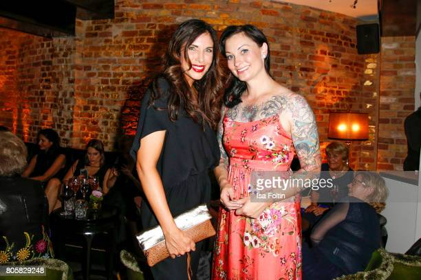 German presenter Alexandra Polzin and German presenter Lina van de Mars during the host of Annabelle Mandengs Ladies Dinner at Hotel Zoo on July 2...