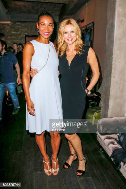 German presenter Annabelle Mandeng and German actress Veronica Ferres during the host of Annabelle Mandengs Ladies Dinner at Hotel Zoo on July 2 2017...