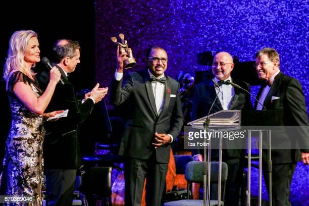 German presenter Carola Ferstl Michael Mronz award winner Michel Sidibe Aldred Weiss and Alard von Rohr during the 24th Opera Gala at Deutsche Oper...
