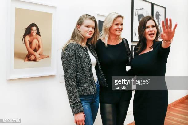 German presenter Carola Ferstl with her daughter Julia Ferstl and former ice skater Katarina Witt during the 'FotoKunstBoulevard' opening at...