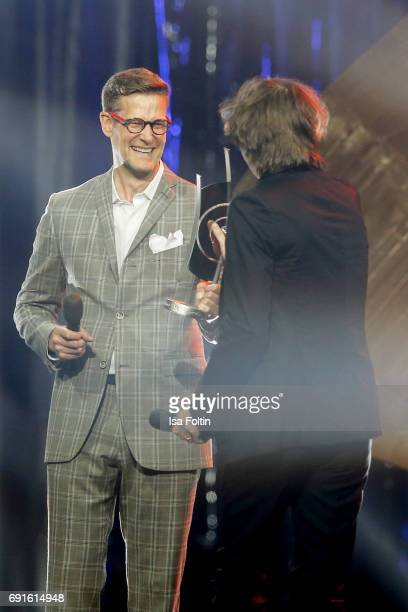 German presenter Goetz Buehler and award winner Michael Wollny for intrumentalist national piano/keyboards during the Echo Jazz 2017 on June 1 2017...