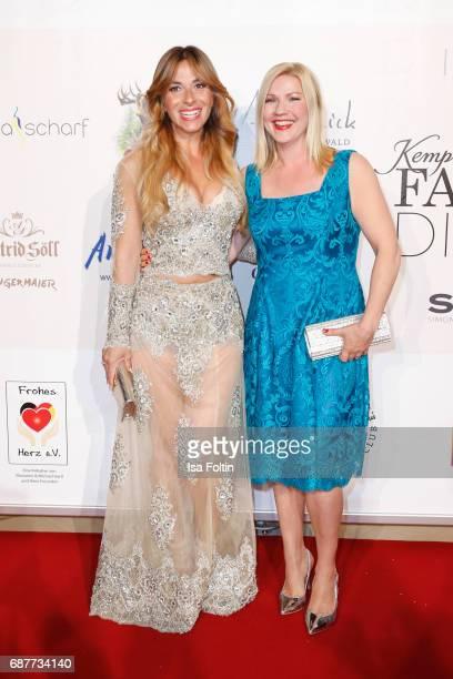 German presenter Guelcan Kamps and german presenter Alexandra Bechtel attend the Kempinski Fashion Dinner on May 23 2017 in Munich Germany