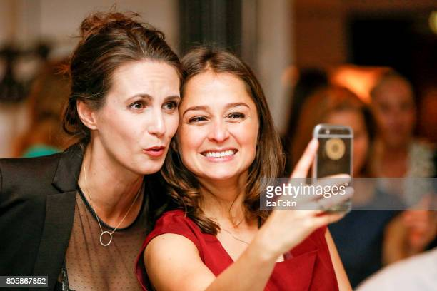 German presenter Katrin Wrobel and German actress Sarah Alles during the host of Annabelle Mandengs Ladies Dinner at Hotel Zoo on July 2 2017 in...