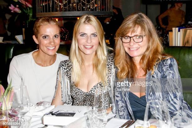 German presenter Kerstin Linnartz German presenter Tanja Buelter and German actess Maren Gilzer during the host of Annabelle Mandengs Ladies Dinner...