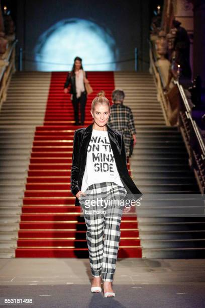 German presenter Kerstin Linnartz walks the runway during the Minx Fashion Night in favour of 'Sauti Kuu' of Auma Obama at Wuerzburger Residenz on...