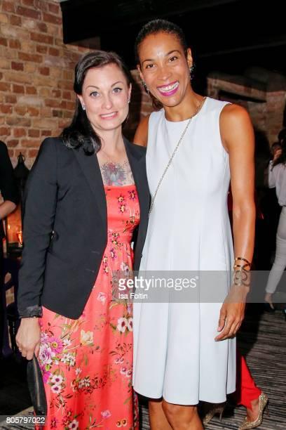 German presenter Lina van de Mars and German presenter Annabelle Mandeng during the host of Annabelle Mandengs Ladies Dinner at Hotel Zoo on July 2...