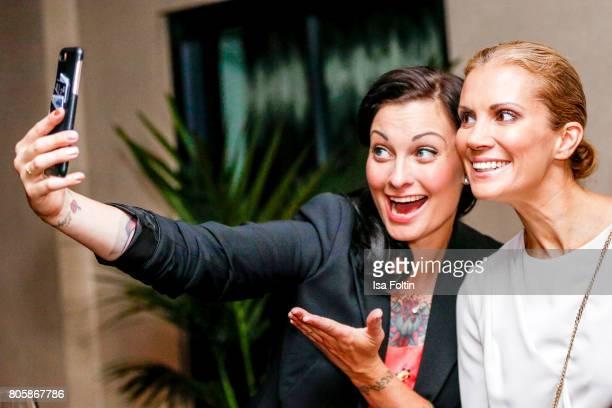 German presenter Lina van de Mars and German presenter Kerstin Linnartz during the host of Annabelle Mandengs Ladies Dinner at Hotel Zoo on July 2...