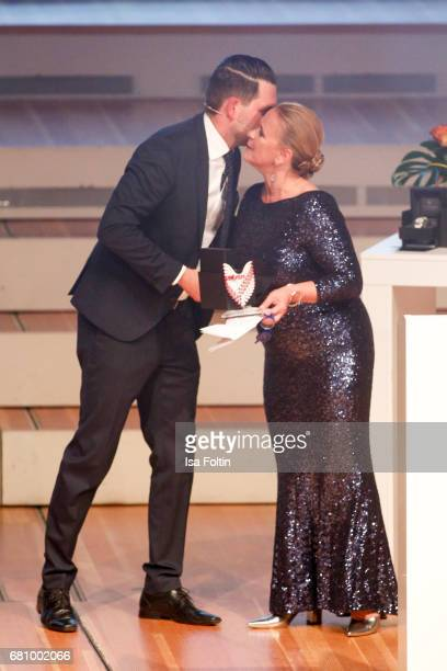 German presenter Matthias Killing with award winner Birgit Gehr during the Victress Awards Gala on May 8 2017 in Berlin Germany