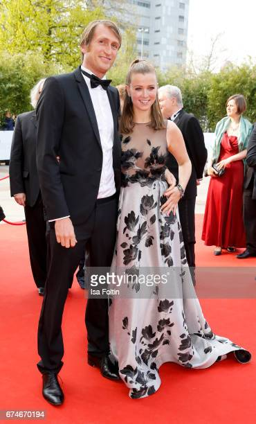 German presenter Nina Eichinger and her partner Fritz Meinikat during the Lola German Film Award red carpet arrivals at Messe Berlin on April 28 2017...
