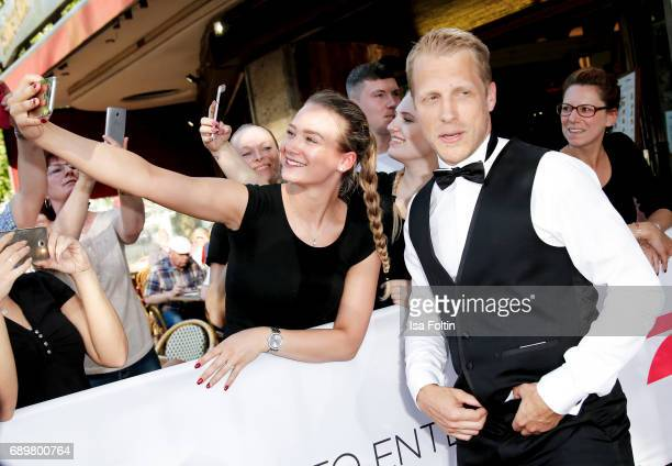 German presenter Oliver Pocher with fans during the 'Global Gladiators' exclusive preview at Astor Film Lounge on May 29 2017 in Berlin Germany