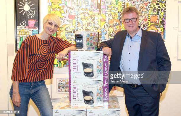 German presenter Susann Atwell and artist Bernd Feil unveil the new Cafissimo Mini coffee maker designed with art by American pop artist James Rizzi...