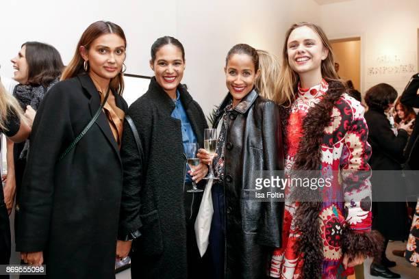 German presenter Wana Limar German presenter Rabea Schif designer Jeanne de Kroon and guest at the Vestiaire Collective and Toni Garrn Charity Sale...