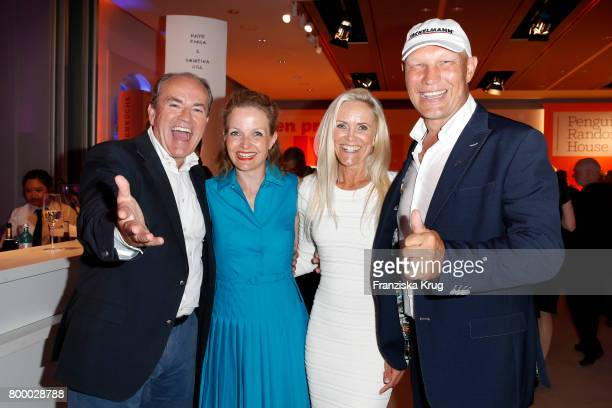 German presenter Wolfram Kons Alexa Apermann Patricia Schulz and Axel Schulz attend the 'Bertelsmann Summer Party' at Bertelsmann Repraesentanz on...