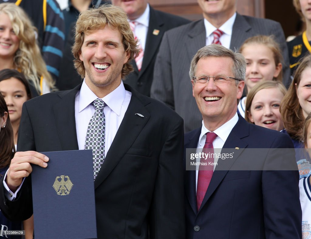 German President Christian Wulff (R) and Dirk Nowitzki (L) pose during the 'Silbernes Lorbeerblatt' (Silver by leaf) ceremony at the presidential Bellevue palace in Berlin on August 28, 2011 in Berlin, Germany. The Silver Bay Leaf is Germany's highest honour for outstanding performance in sports.