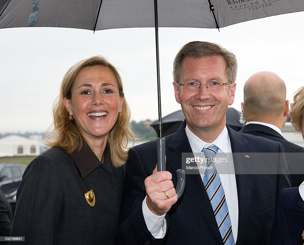 German President <a gi-track='captionPersonalityLinkClicked' href=/galleries/search?phrase=Christian+Wulff&family=editorial&specificpeople=221618 ng-click='$event.stopPropagation()'>Christian Wulff</a> and First Lady Bettina arrive at the boat bridge Loschwitz on September 1, 2010 in Dresden, Germany. The Wulffs are on a one-day visit to Saxony.