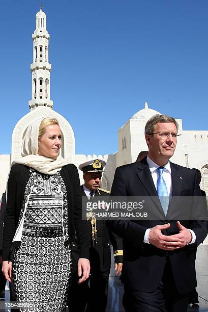 German President Christian Wulff and First Lady Bettina Wulff arrive for a visit to the Sultan Qaboos Grand Mosque in Muscat on December 10 2011...