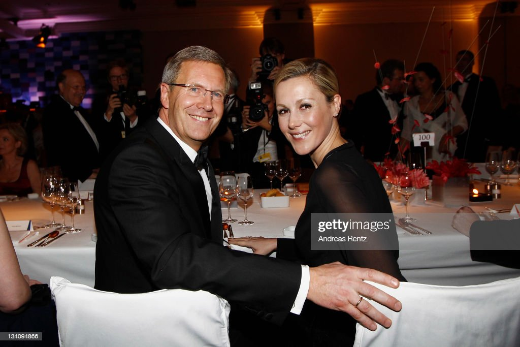 German President <a gi-track='captionPersonalityLinkClicked' href=/galleries/search?phrase=Christian+Wulff&family=editorial&specificpeople=221618 ng-click='$event.stopPropagation()'>Christian Wulff</a> and First Lady <a gi-track='captionPersonalityLinkClicked' href=/galleries/search?phrase=Bettina+Wulff&family=editorial&specificpeople=5780590 ng-click='$event.stopPropagation()'>Bettina Wulff</a> attend the Bundespresseball at Hotel Intercontinental on November 25, 2011 in Berlin, Germany.