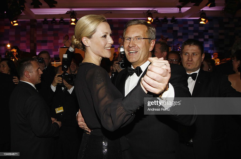 German President Christian Wulff and First Lady Bettina Wulff attend the Bundespresseball at Hotel Intercontinental on November 25 2011 in Berlin...