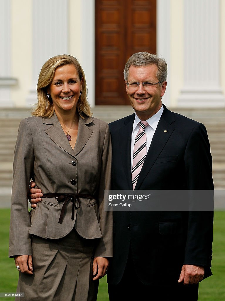 German President <a gi-track='captionPersonalityLinkClicked' href=/galleries/search?phrase=Christian+Wulff&family=editorial&specificpeople=221618 ng-click='$event.stopPropagation()'>Christian Wulff</a> and his wife First Lady <a gi-track='captionPersonalityLinkClicked' href=/galleries/search?phrase=Bettina+Wulff&family=editorial&specificpeople=5780590 ng-click='$event.stopPropagation()'>Bettina Wulff</a> pose in front of Schloss Bellevue Palace on August 6, 2010 in Berlin, Germany. Wulff took office on July 2, 2010 and at 51 is Germany's youngest president ever.