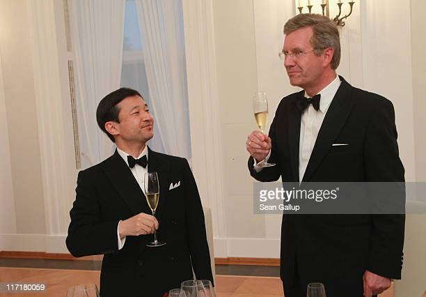 German President Christian Wulff and HRH Crown Prince Naruhito of Japan toast one another with champagne at a dinner given by Wulff in the Crown...