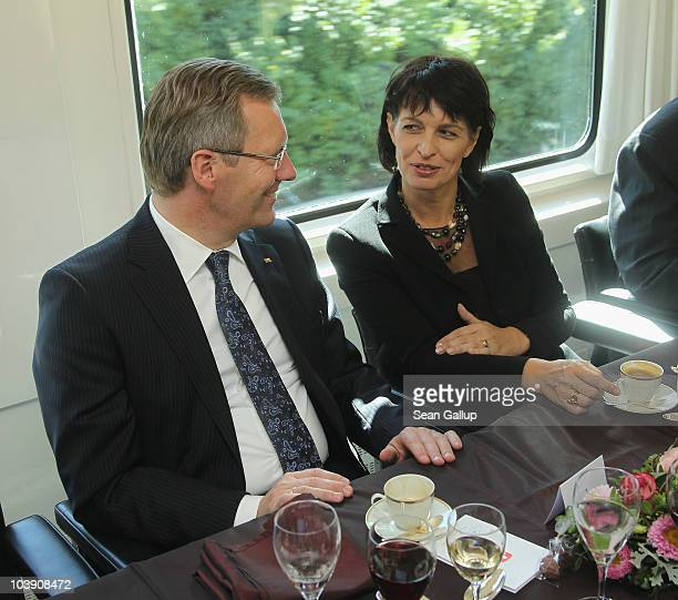 German President Christian Wulff and Swiss President Doris Leuthard chat on a train from Zurich as they arrive on September 8 2010 in Bern...