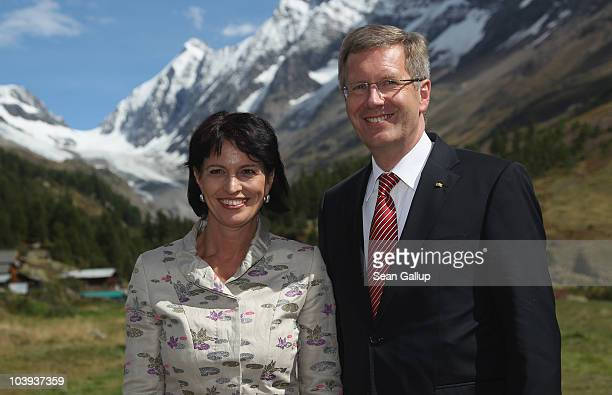 German President Christian Wulff and Swiss President Doris Leuthard pose for a picture in the Swiss Alps after arriving by helicopter for lunch on...