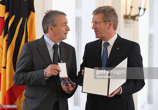 German President Christian Wulff awards the Federal Cross of Merit to Wolfgang Niersbach General Secretary of the German Football Federation at a...