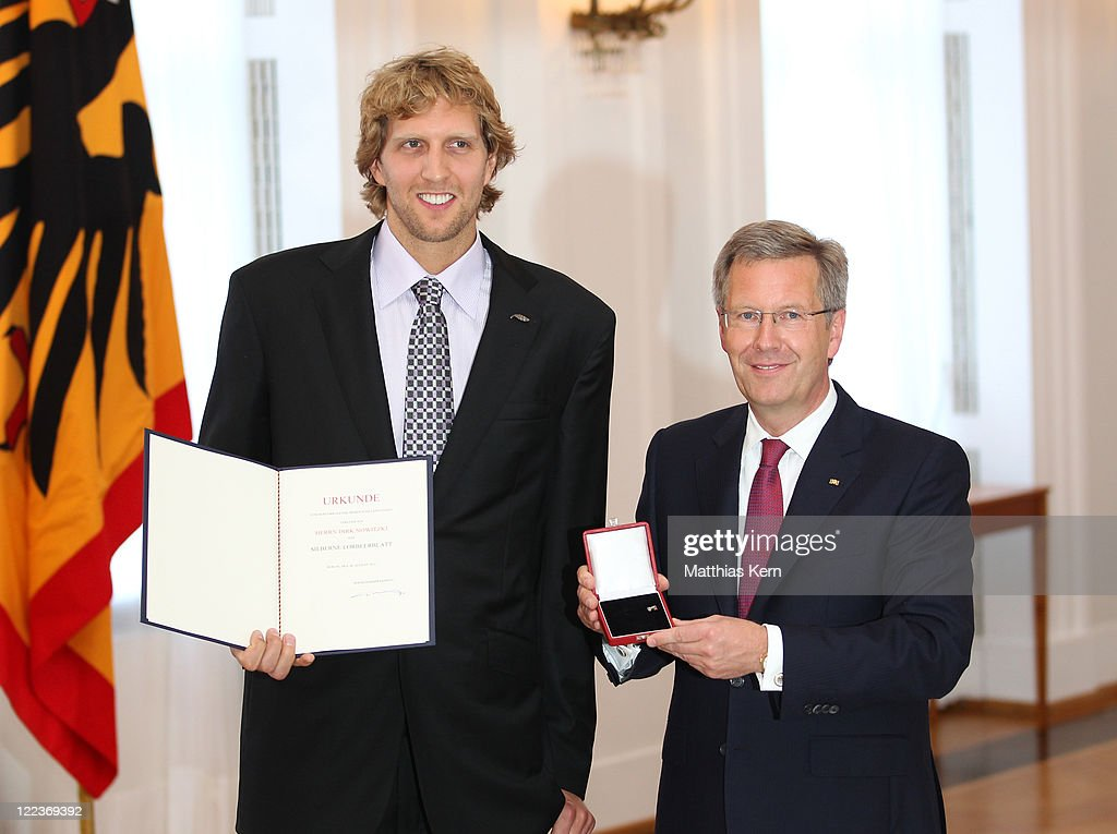 German President <a gi-track='captionPersonalityLinkClicked' href=/galleries/search?phrase=Christian+Wulff&family=editorial&specificpeople=221618 ng-click='$event.stopPropagation()'>Christian Wulff</a> (R) honors <a gi-track='captionPersonalityLinkClicked' href=/galleries/search?phrase=Dirk+Nowitzki&family=editorial&specificpeople=201490 ng-click='$event.stopPropagation()'>Dirk Nowitzki</a> with the 'Silbernes Lorbeerblatt' (Silver by leaf) during a ceremony at the presidential Bellevue palace in Berlin on August 28, 2011 in Berlin, Germany. The Silver Bay Leaf is Germany's highest honour for outstanding performance in sports.