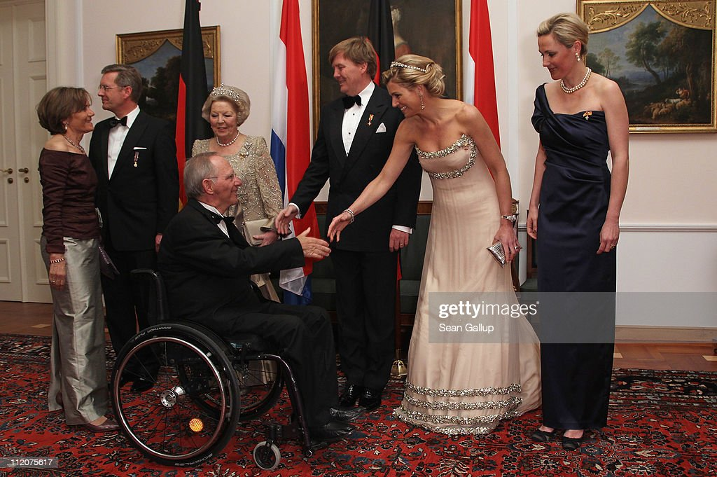German President <a gi-track='captionPersonalityLinkClicked' href=/galleries/search?phrase=Christian+Wulff&family=editorial&specificpeople=221618 ng-click='$event.stopPropagation()'>Christian Wulff</a>, Queen Beatrix of the Netherlands, Prince Willem-Alexander of the Netherlands, Princess Maxima of the Netherlands and German First Lady <a gi-track='captionPersonalityLinkClicked' href=/galleries/search?phrase=Bettina+Wulff&family=editorial&specificpeople=5780590 ng-click='$event.stopPropagation()'>Bettina Wulff</a> greet German Finance Minister Wolfgang Schaeuble and his wife Ingeborg as they attend a state banquet given in honour of the visiting Dutch royals at Bellevue Presidential Palace on April 12, 2011 in Berlin, Germany. The Dutch royals, including Queen Beatrix, Prince Willem-Alexander and Princess Maxima, are on a four-day visit to Germany that includes stops in Berlin, Dresden and Duesseldorf.
