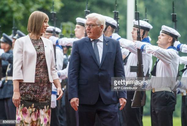 German President FrankWalter Steinmeier and his Estonian counterpart Kersti Kaljulaid review an honour guard in Tallinn on August 22 2017 as the...