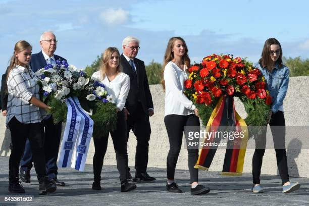 German President FrankWalter Steinmeier and his Israeli counterpart Reuven Rivlin carry a wrath of flowers to the International Memorial of former...