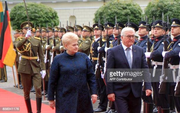 German President FrankWalter Steinmeier and Lithuanian President Dalia Grybauskaite review the guard of honor prior to a meeting at the presidential...