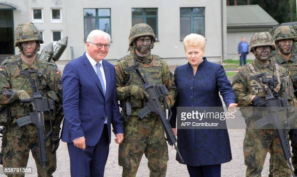 German President FrankWalter Steinmeier and Lithuanian President Dalia Grybauskaite pose with soldiers serving in the NATO enhanced Forward Presence...