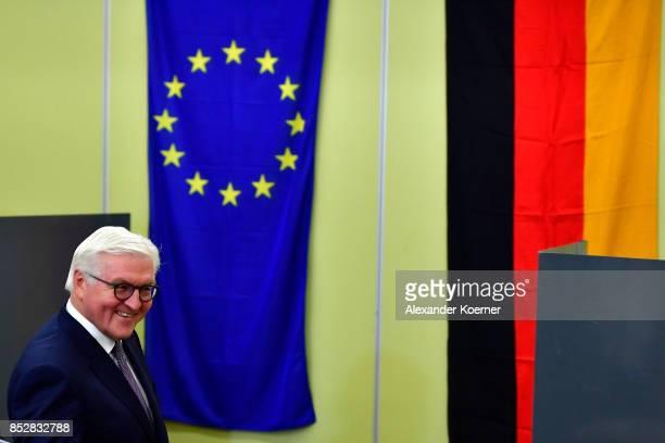 German President FrankWalter Steinmeier arrives to cast his ballot in German federal elections on September 24 2017 in Berlin Germany Germans are...