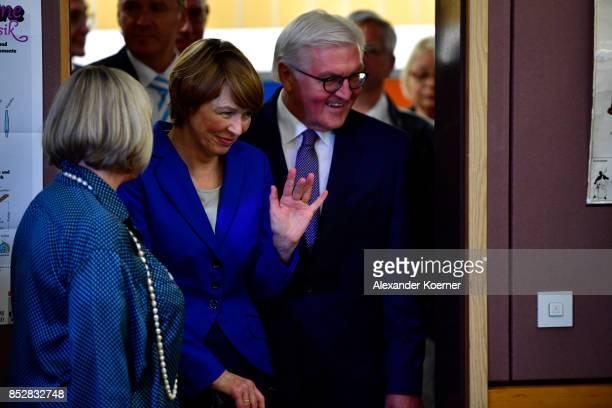 German President FrankWalter Steinmeier arrives with his wife Elke Buedenbender to cast his ballot in German federal elections on September 24 2017...