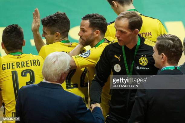 German President FrankWalter Steinmeier congratulates Dortmund's head coach Thomas Tuchel and his players after the German Cup final football match...