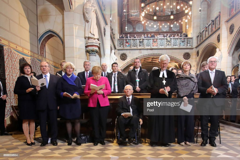 German President Frank-Walter Steinmeier, his wife Elke Buedenbender, the Chair of the Council of the Evangelical Church in Germany Heinrich Bedford-Strohm, the President of the Bundestag (lower house of parliament) Wolfgang Schaeuble, German Chancellor Angela Merkel, the Federal Government's Commissioner for Culture and the Media Monika Gruetters and Saxony-Anhalt's State Premier Reiner Haseloff attend a religious service to commemorate the 500th anniversary of the Reformation at Schlosskirche church on Reformation Day on October 31, 2017 in Wittenberg, Germany. Theologian Martin Luther nailed his 95 theses to the doors of the Schlosskirche in 1517 in an appeal for reform within the Catholic Church. He also held the first mass in the vernacular at the nearby Sankt Marien church. Germany is today celebrating the 500th anniversary of the Reformation that Luther set in motion and that led to the creation of successful Protestant movements in history's most significant challenge to the Catholic Church. Luther's translation of the Bible made it accessible to a much broader audience. He spoke out against the practice of indulgences and the sale of relics, and also argued that a place in Heaven is possible not by good deeds but through faith.