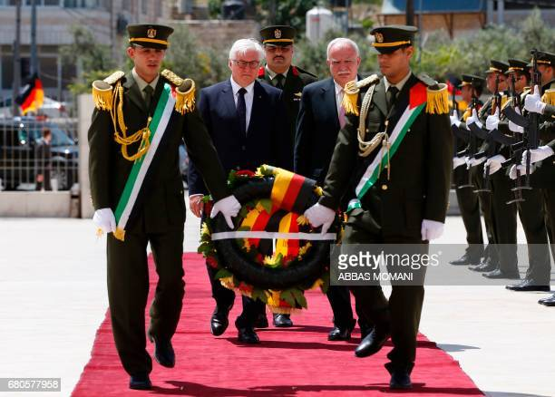 German President FrankWalter Steinmeier prepares to lay a wreath on the grave of the late Palestinian leader Yasser Arafat at the Palestinian...