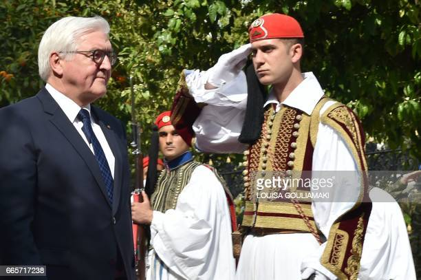 German President FrankWalter Steinmeier reviews the presidental guard during an official welcome ceremony prior to a meeting with his Greek...