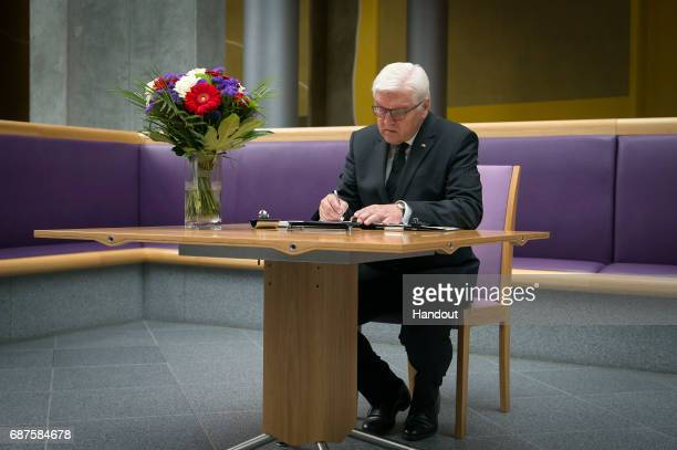 German President FrankWalter Steinmeier writes in a book of condolence to commemorate the victims of the attack in Manchester on May 24 2017 in...