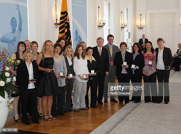 German President Horst Koehler and German Defense Minister KarlTheodor zu Guttenberg pose with members of the German deaf national women's football...