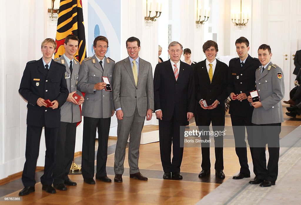 German President Horst Koehler (4th from R) and German Defense Minister <a gi-track='captionPersonalityLinkClicked' href=/galleries/search?phrase=Karl-Theodor+zu+Guttenberg&family=editorial&specificpeople=5585450 ng-click='$event.stopPropagation()'>Karl-Theodor zu Guttenberg</a> (4th from L) pose with <a gi-track='captionPersonalityLinkClicked' href=/galleries/search?phrase=Michael+Uhrmann&family=editorial&specificpeople=722919 ng-click='$event.stopPropagation()'>Michael Uhrmann</a> (L) and <a gi-track='captionPersonalityLinkClicked' href=/galleries/search?phrase=Andreas+Wank&family=editorial&specificpeople=2507492 ng-click='$event.stopPropagation()'>Andreas Wank</a> (2ndL) of the German flying team and <a gi-track='captionPersonalityLinkClicked' href=/galleries/search?phrase=Tino+Edelmann&family=editorial&specificpeople=774954 ng-click='$event.stopPropagation()'>Tino Edelmann</a> (3rdL), Johannes Rydek (3rdR), Bjoern Kircheisen (2ndR) and <a gi-track='captionPersonalityLinkClicked' href=/galleries/search?phrase=Eric+Frenzel&family=editorial&specificpeople=4595984 ng-click='$event.stopPropagation()'>Eric Frenzel</a> (R) of the German nordic combined team at the Silbernes Lorbeerblatt Award at Bellevue palace on April 30, 2010 in Berlin, Germany. The Silver Bay Leaf is Germany's highest athletic honour for outstanding performance in sports.